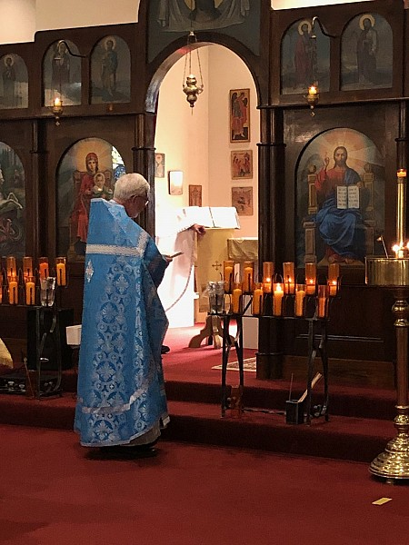 Fr. John reading the ambo prayer at the end of Divine Liturgy