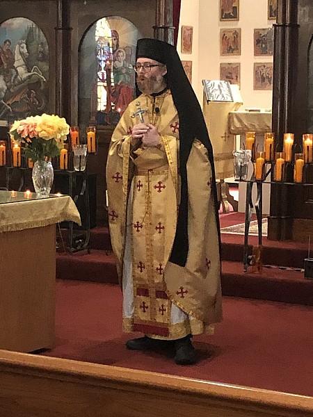 Fr. Nikodham addresses the parishioners at the dismissal